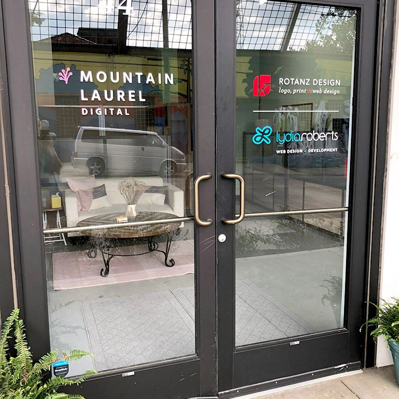 Double office doors with logos